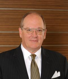 Man in glasses in black suit