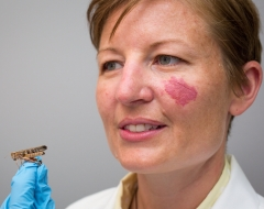 Lady holding a grasshopper