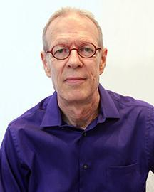 Man in purple shirt and glasses