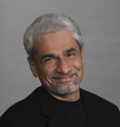 Man with grey hair and black shirt