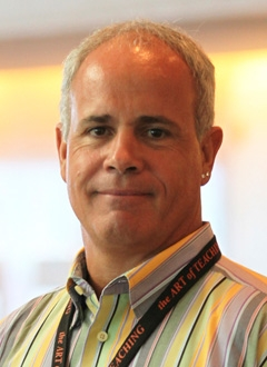 Man in grey hair smiling