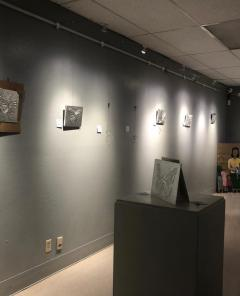 The class' repujado art pieces hanging in the Phoenix Center for the Arts