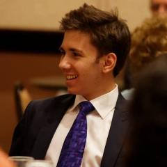Young man in suit and tie smiling