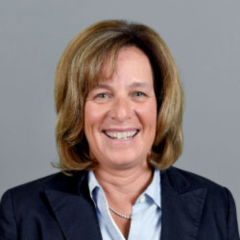 Woman in business suit smiling