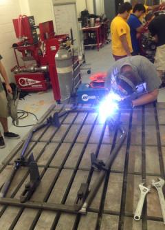 student welding car