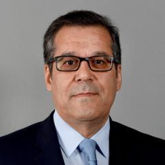 Man in tie wearing glasses