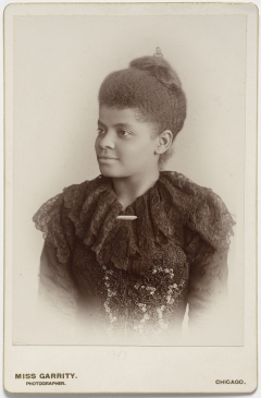 black and white photo of woman from the 19th century