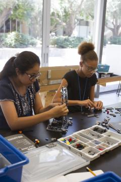two students working with LEGOS