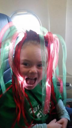 A little girl wears a glowing headband.