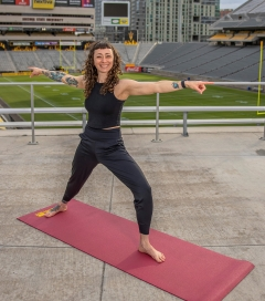 Instructor  leads a yoga class from Sun Devil Stadium