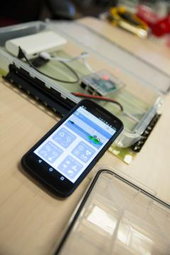 SolarSPELL's digital library connected to a smartphone.